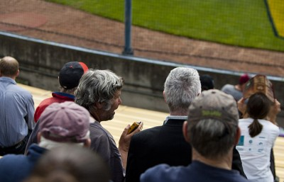 Jerry Broody, left, and Deryl Wilkerson take in a Cal baseball game. The two men, who are both visually impaired, rely on their transistor radios to follow the action.
