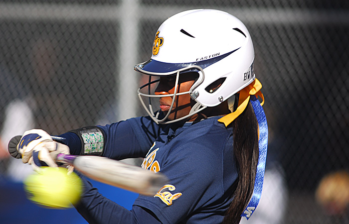 Jamia Reid, #3, hits the ball for a run to first base late in the game.