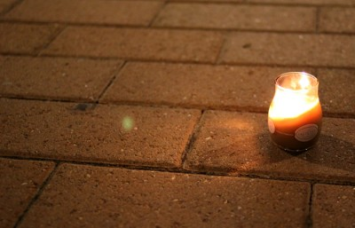 Candles were lit and placed outside of Unit 2 after the incident occurred. Alice Oh/Staff