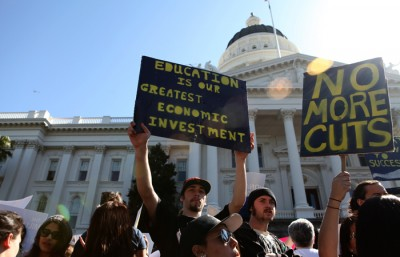 Protesters, numbering in the thousands, gather in front of the Capitol building in Sacramento in a rally earlier this year to advocate for higher education.