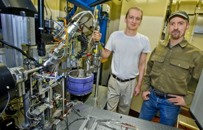 Simon Morton (left) and Jeff Dickert (right), two recipients of the R&D 100 awards, are pictured with the Beamline 5 collimator.