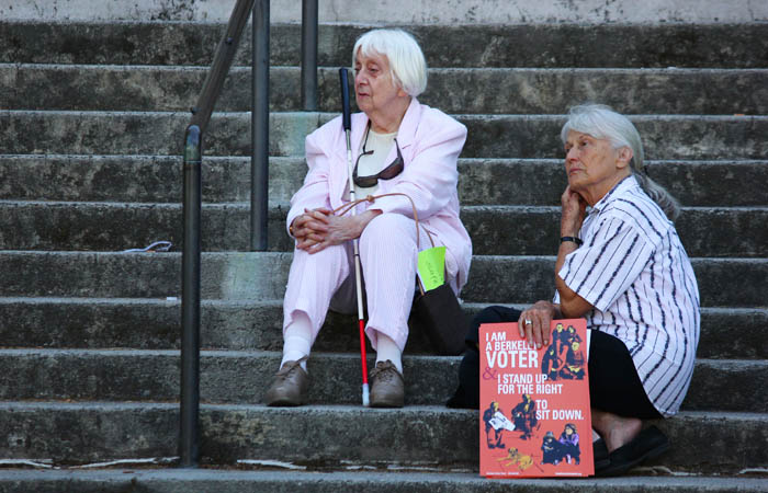 Ann Fagan Ginger and Ingrid Kepler-May, along with others sat on the steps of city hall to protest the proposed civil sidewalk measure that was later passed Tuesday evening.