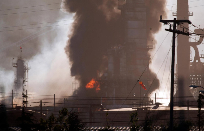 Smoke billows from a crude oil unit at the Chevron refinery in Richmond.
