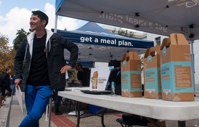 "Gary Duan, from Back to the Roots, a company founded by Berkeley graduates, holds a raffle for a free ""Grow Your Own Mushroom Garden"" as part of Food Day events put on by University Health Services."