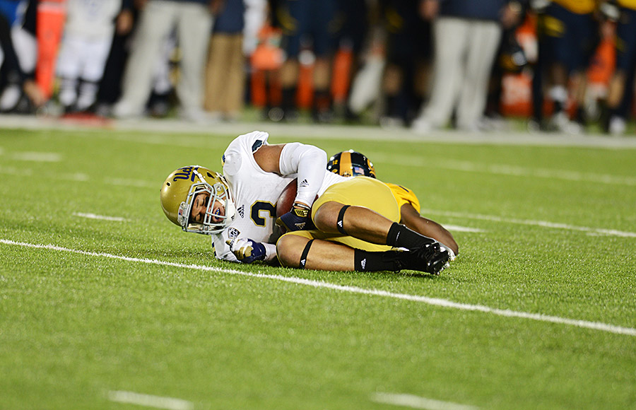 UCLA #3 Darius Bell on the ground after being tackled. (Tony Zhou/Staff)