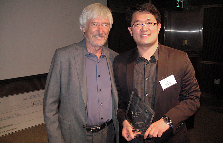 Aijun Wang, right, and Zhenyu Tang, not pictured, won the 2012 Deloitte QB3 Award for Innovation for their research into the effects of stems cells on vascular diseases.