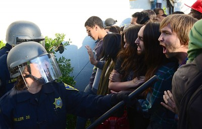 UCPD officers use batons during a protest on November 9, 2011 in front of Sproul Hall.
