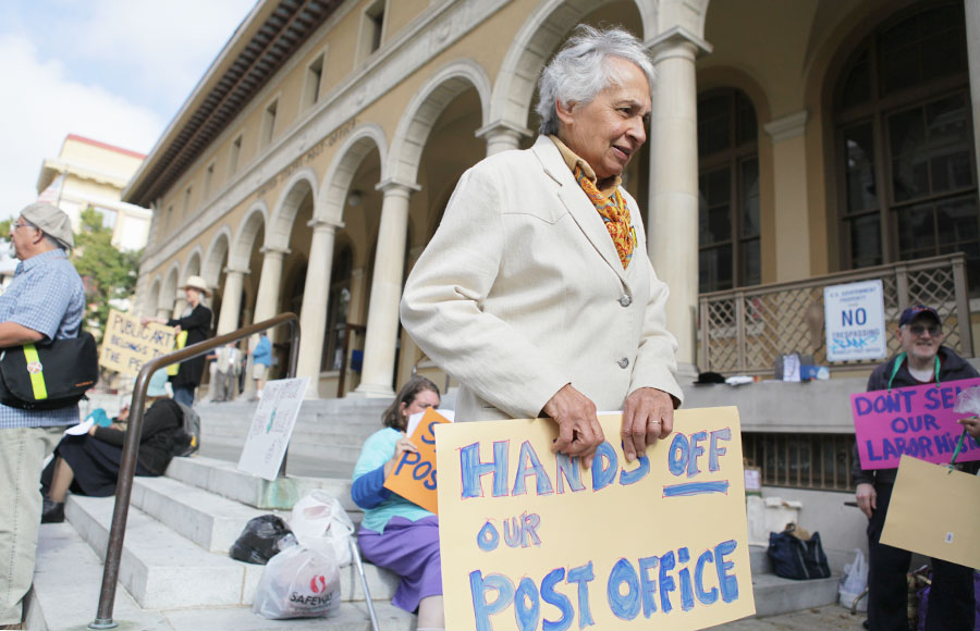 Community members protest the sale of the main branch of Berkeley's post office on July 24th. Another protest took place on Wednesday.