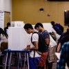 A student votes at a polling station at Unit 2.