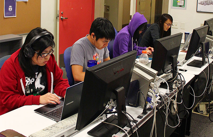 Students are hard at work in a computer science lab in Soda Hall. Some experts are arguing that programming is a new form of literacy that may soon join the ranks of reading and writing skills.