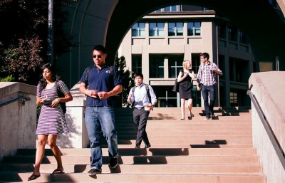 Students walk out through the Cronk Gate of the Haas School of Business. New rankings released by Businessweek Friday place the school at a low 57th for return on investment.