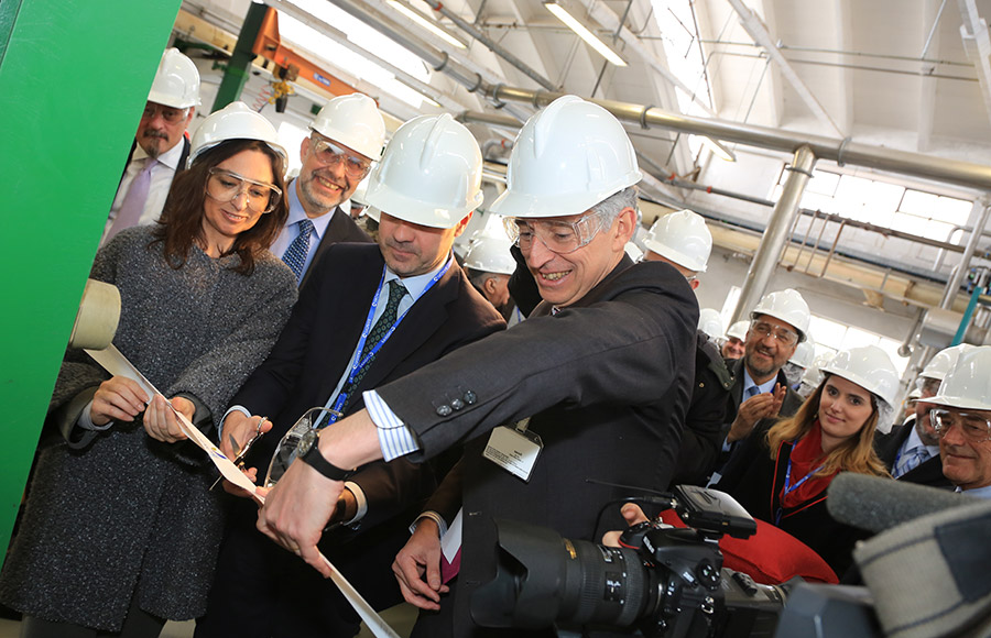Employees of Sanofi, a pharmaceutical company based in Italy, attend a ribbon-cutting ceremony at the company's Garessio site. Sanofi plans to produce massive quantities of semisynthetic artemisinin, which some hope will provide a cheaper treatment for malaria.