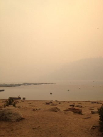 Smoke from the Rim Fire hangs over Lake Pinecrest, near the Lair of the Golden Bear camp.
