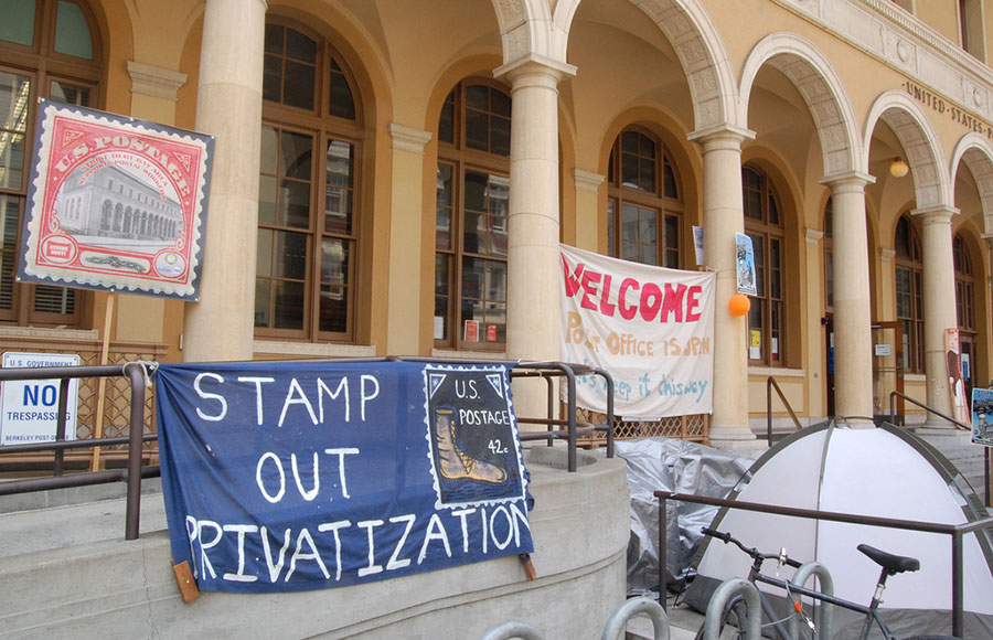 Protesters continue to occupy outside the Downtown Berkeley Post Office despite warnings.