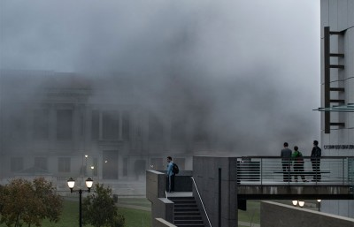 Students watch as smoke slowly rolls through campus.