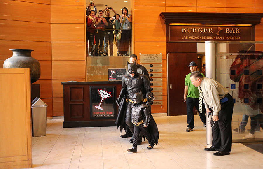 Miles Scott, aka Batkid, leads Batman out to Union Square on his way to saving Lou Seal at AT&T Park.