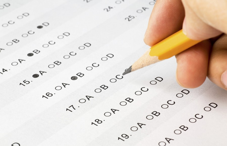 Picture of someone taking a standardized test like the SAT