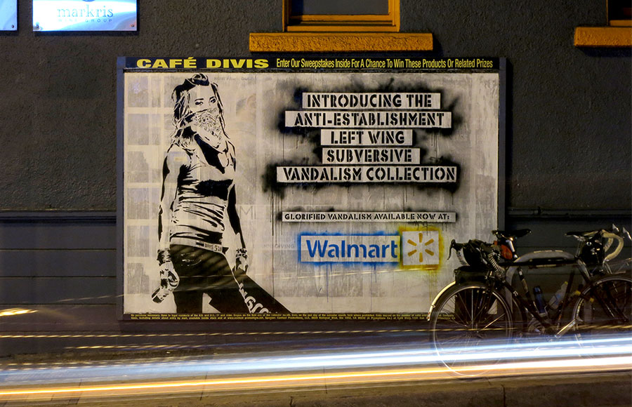 Street artist Eddie Colla took over a San Francisco billboard after he discovered Wal-Mart and other retailers were selling prints of his work without   his permission or proper attribution. Colla, who said others approached him with similar complaints, intends to sue those who distributed his art.