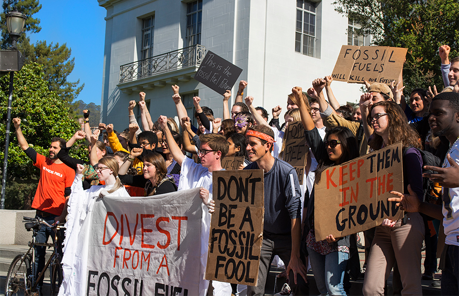 Student campaigns such as Fossil Free Cal, shown here at a protest on Sproul Plaza in October 2013, have been urging divestment from fossil fuel-related companies by the university. A Graduate Assembly resolution also calls for divestment by the campus and university.