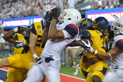 Despite four defenders, Arizona redshirt senior Austin Hill (29) catches the ball in the end zone during the 4th quarter of Arizona's 49-45 win against Cal at Arizona Stadium on Saturday, Sept. 20, 2014.