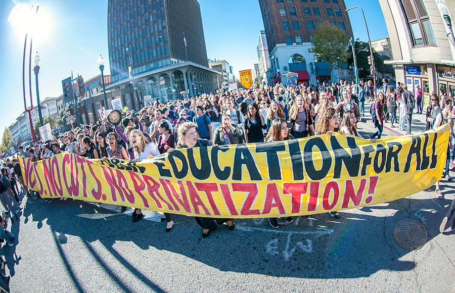 Hundreds of UC Berkeley students, faculty and community members marched through the city and campus on November 24 as part of a systemwide day of action, protesting the recent vote by the UC Board of Regents to pass a controversial tuition hike policy.
