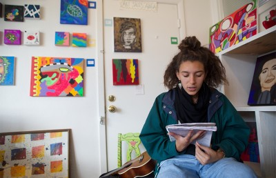 16-year-old Jada Carter reads her spoken-word poetry out loud at Youth Spirit Artworks, an art studio that offers transition-age youth experiencing poverty, fractured homes or homelessness opportunities to develop their own artwork and cultivate skills as a way to begin entering the job market.  Rachael Garner