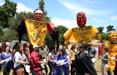 Lecturers and supporters hold a picnic at UC Santa Cruz with food and puppets, marking the beginning of union negotiations with the university.
