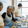 UC Berkeley junior Virginia Yen, center, serves a meal at the Berkeley Food and Housing Project, which serves hot meals to more than 150 individuals four nights a week.