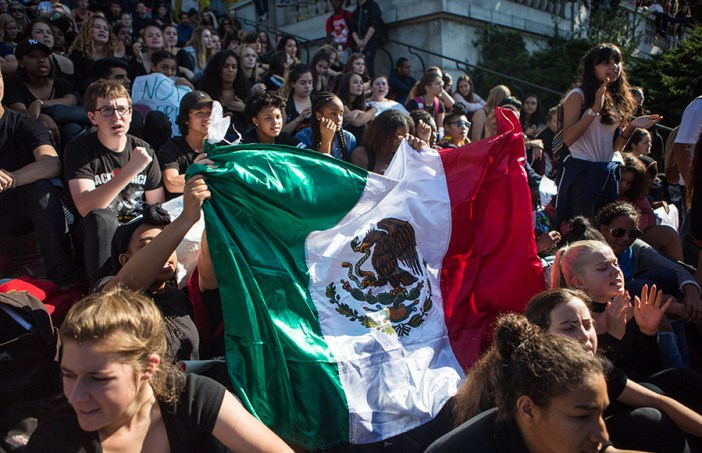 """Berkeley High School students wave a Mexican flag while chanting """"not our president"""" in opposition of Donald Trump's election as US President on Wednesday, November 9, 2016 in Berkeley, Calif. (Rachael Garner/Senior Staff)"""