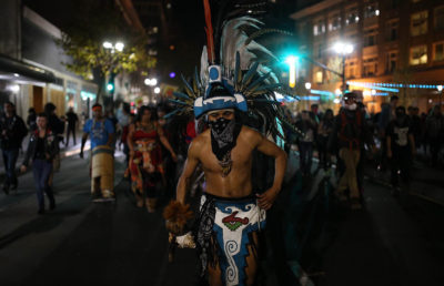 Protesters unaffiliated with BAMN march through Oakland on Thursday night. While there were some instances of vandalism, the demonstration was largely peaceful.
