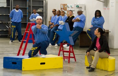Inmates prepare for their performance.