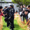Protesters yell at each other in alt-right rally April 15 at Civic Center Park, while police stand between the groups.