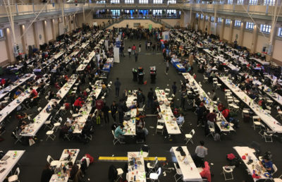 Arial view of the Yhacks hackathon floor, with hundreds of tables and students