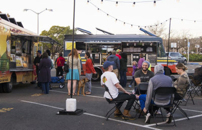 People enjoy food at the food truck market Off the Grid at North Berkeley BART station in 2016.