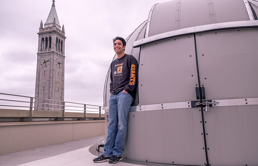 Fifth-year Haynes Stephens with the UC Berkeley Astronomy department telescope. Stephens uses microlensing to search for black holes.