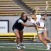 Lacrosse player Eliza Christman dodges her opponent