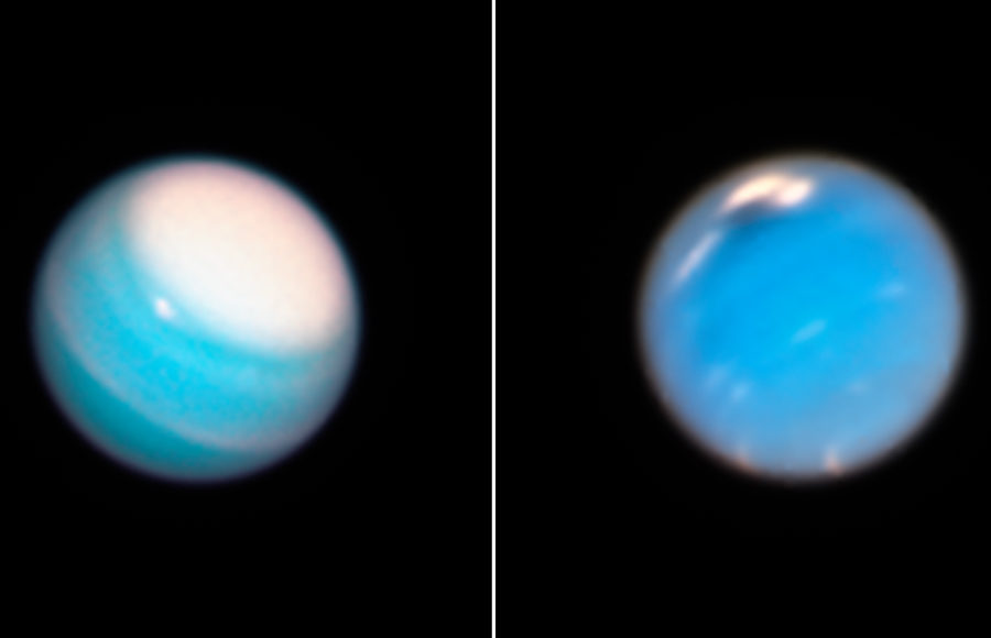 Two blue planets are pictured in outer space.