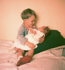 1956 Robin with new baby sister Aileen (Photo credit: Robin Hutton)