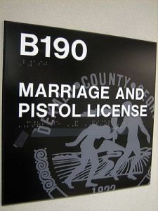 """MARRIAGE AND PISTOL LICENSE"" office sign, Dekalb County, Georgia (United States) (Photo credit: Wikipedia)"