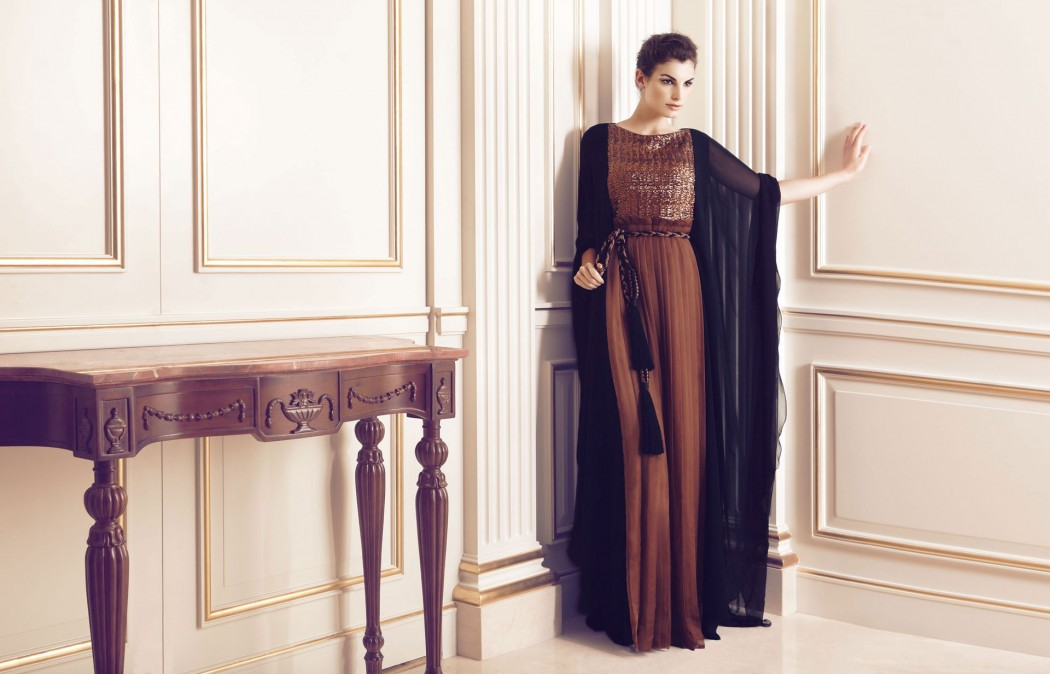 This bronze colored abaya takes things up a notch. The color makes it look luxurious and regal, while the pleats add structure