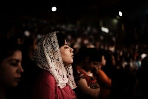 Worshippers attend a service at the St Samaans (Simon) Church also known as the Cave Church in the Mokattam village in Cairo (file photo: AFP PHOTO/GIANLUIGI GUERCIA)