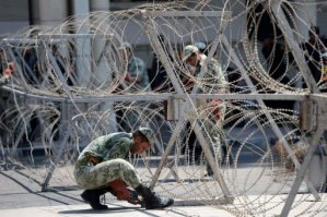 Soldiers set up barbed wire fences outside the presidential palace but just 200 demonstrators showed up (AFP/File, Khaled Desouki)