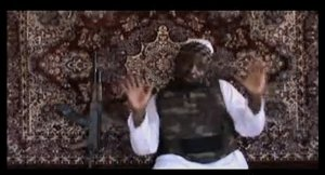 This undated image grab taken on 5 August from a video uploaded on YouTube purportedly shows Boko Haram leader Abubakar Shekau speaking in a 38-minute clip, would could not be independently verified as authentic, but it was similar to previous videos of Shekau AFP PHOTO / YOUTUBE