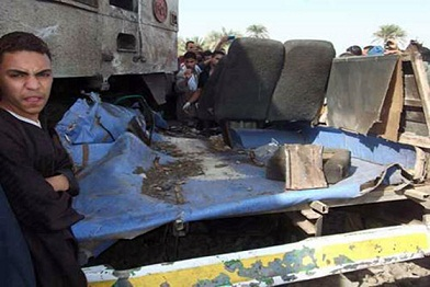 Wreckage of a school bus lies tangled with the train that crashed into it killing dozens of children. (DNE / MOHAMED OMAR)