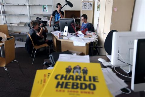 French satirical weekly Charlie Hebdo's publisher and cartoonist, known only as Charb, at his desk on 19 September, 2012 in Paris. (AFP PHOTO/ THOMAS SAMSON)