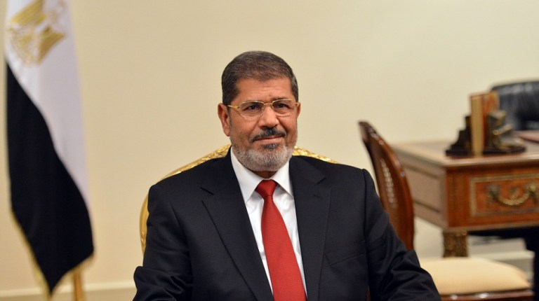 """""""The country is running several development projects in the Suez Canal, North Siwa, Nubia, New Valley, Nasser Lake and North Coast,"""" Morsi said. AFP PHOTO/KHALED DESOUKI"""