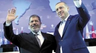 Perdana menteri Erdogan dan presiden Mursi (zamnpress.com)