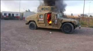 Kendaraan militer terbakar di Mosul (Memo Islam)