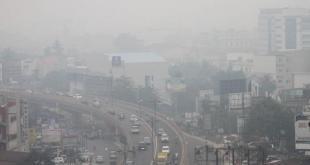 Kabut asap menyelimuti kota Pekanbaru, Riau dan menyebabkan 25.000 warga menderita ISPA.  (kopas.com)