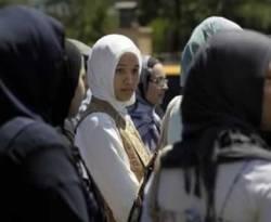 Imane Boudlal mengenakan jilbab putih (AP)
